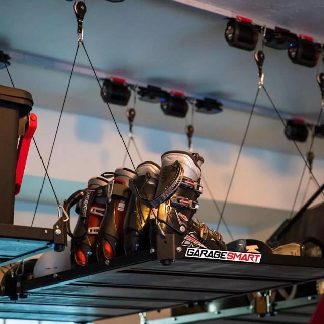 Skis and Helmets Stored on Garage Ceiling. Photo by Instagram user @garagesmart