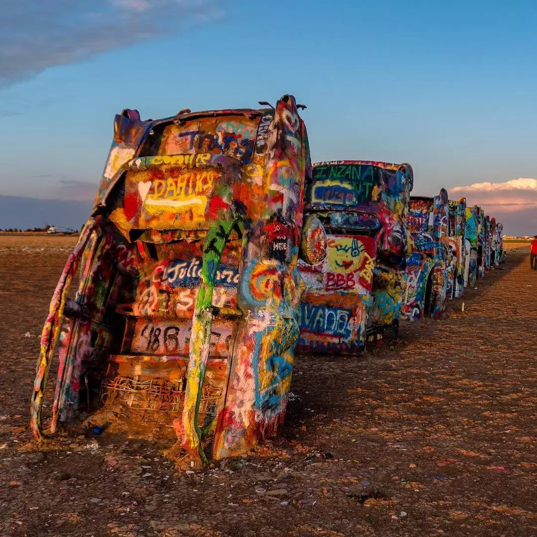 Painted Cars in the Ground at Cadillac Ranch. Photo by Instagram user @shotsbyandy
