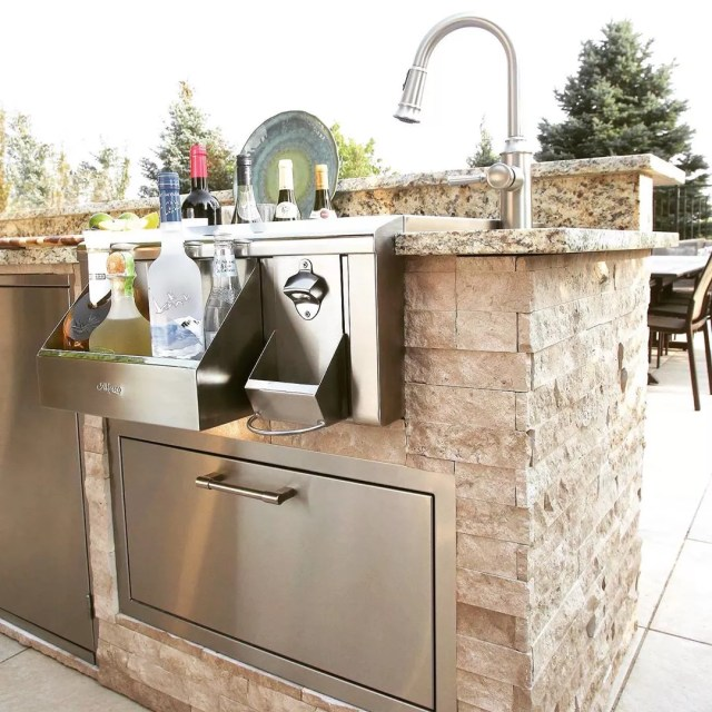 outdoor bar station with wine cooler and bottle opener photo from Instagram user @outdoorelegance