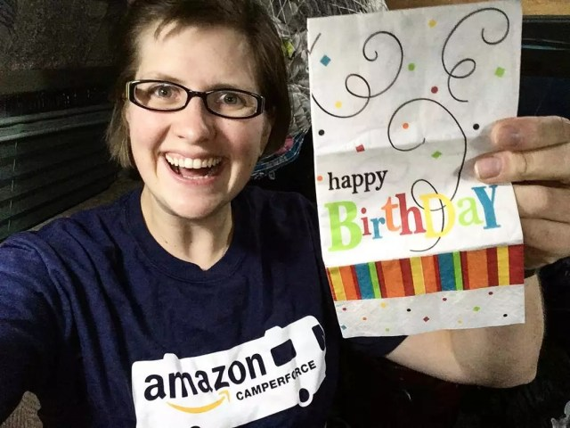 Amazon CamperForce Worker Holding Up a Happy Birthday Sign from Her Employer. Photo by Instagram user @rebekahs_adventures