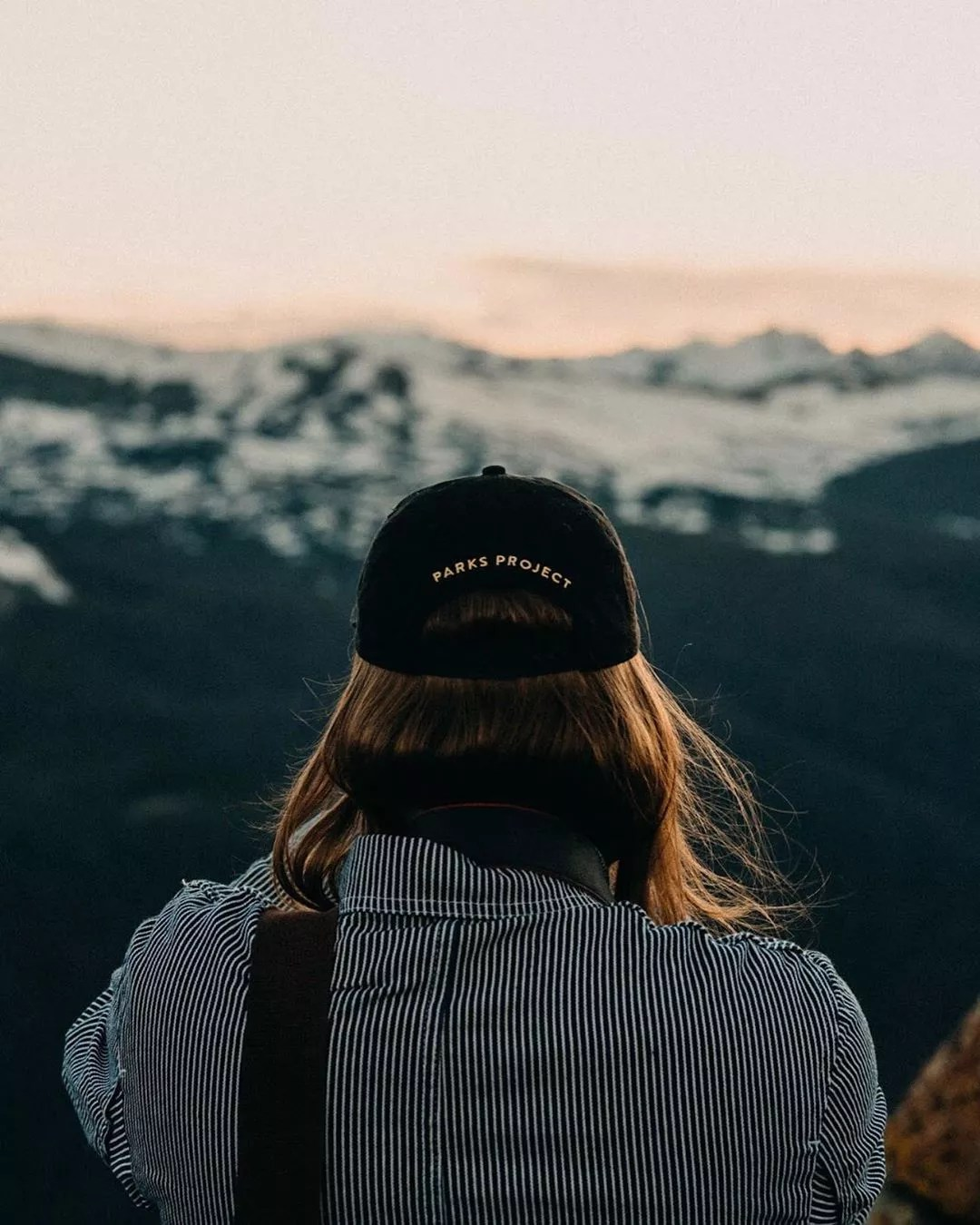 Blogger Overlooking the Mountains at Sunset in Colorado. Photo by Instagram user @tuckerneffewing