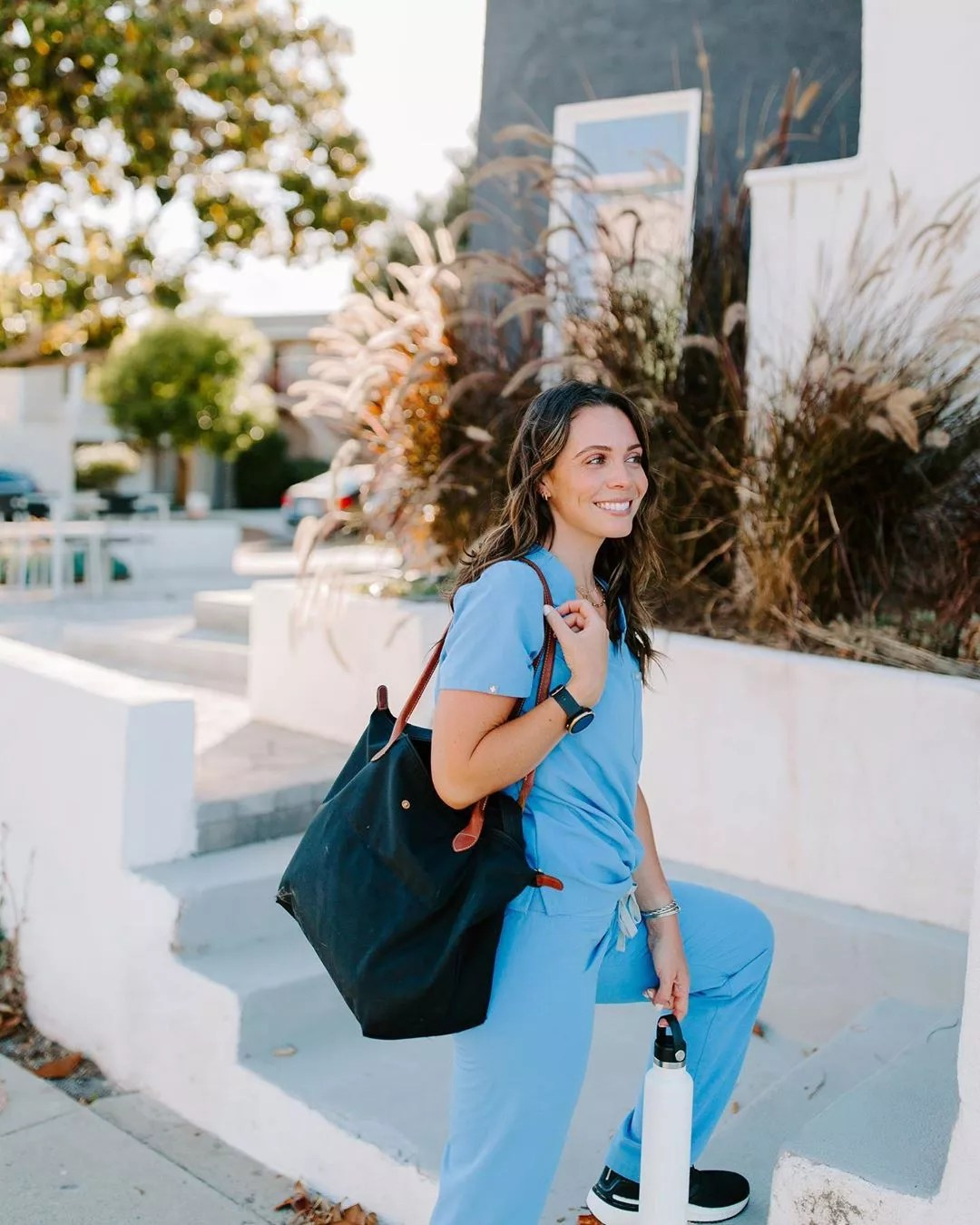 Nurse with a Traveling Bag Approaching Hospital Steps. Photo by Instagram user @becksliveshealthy
