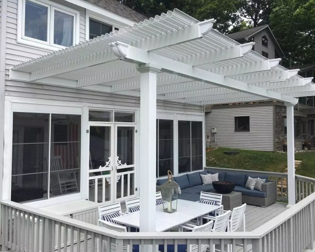 white deck with pergola attached to the house over the deck photo by Instagram user @ahrremodeling
