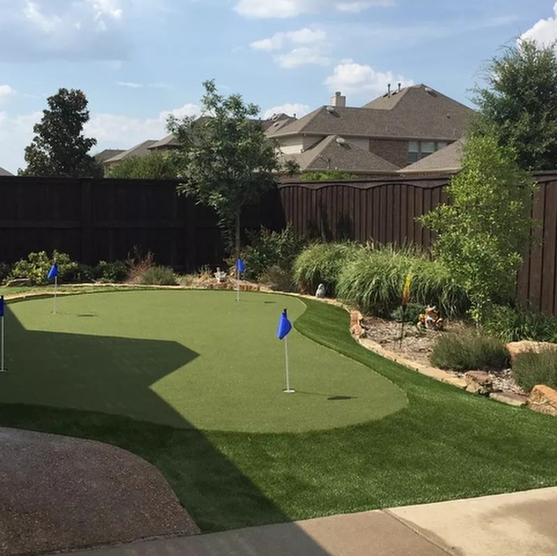 backyard putting green with three holes using fake turf photo by Instagram user @scott_dfw_turf