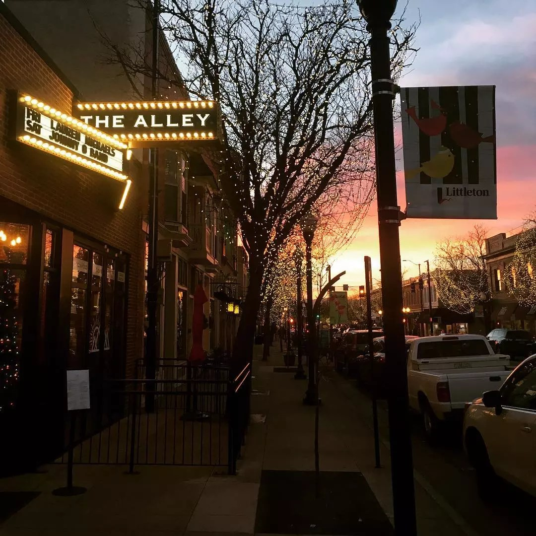 Looking down a Littleton street at sunset in front of The Alley venue Photo by Instagram user @benhammondmusic