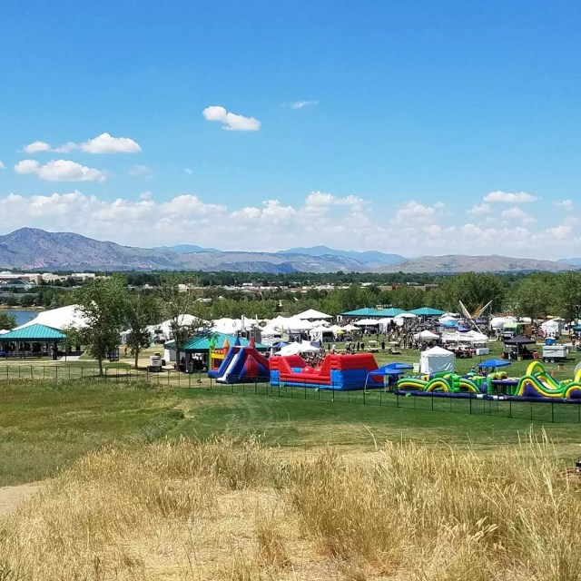 Overlooking tents and vendors at the Colorado Irish Festival with mountains in the background Photo by Instagram user @jpflynn11