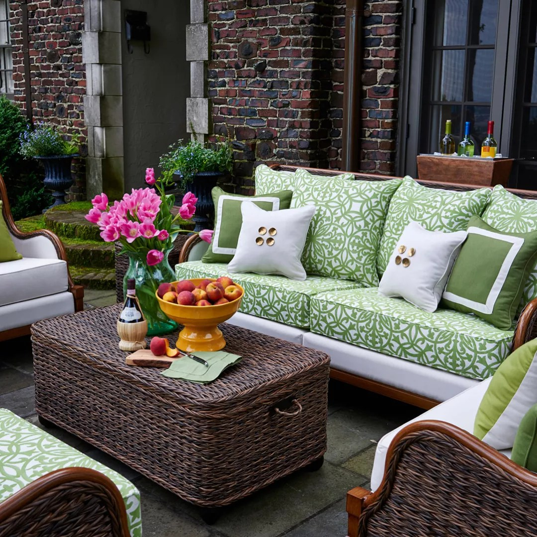outdoor furniture with green and white cushions set up around coffee table photo by Instagram user @peakseason