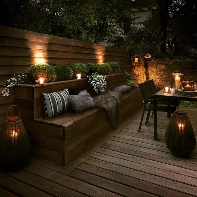 candles set up around an outdoor living space photo by Instagram user @1111designco