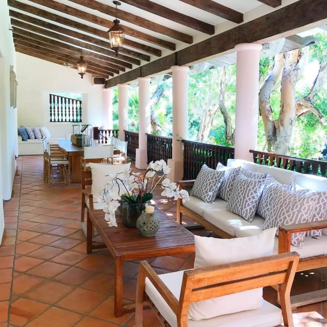 covered deck with tile floor and outdoor seating placed throughout photo by Instagram user @kathleeninsocal