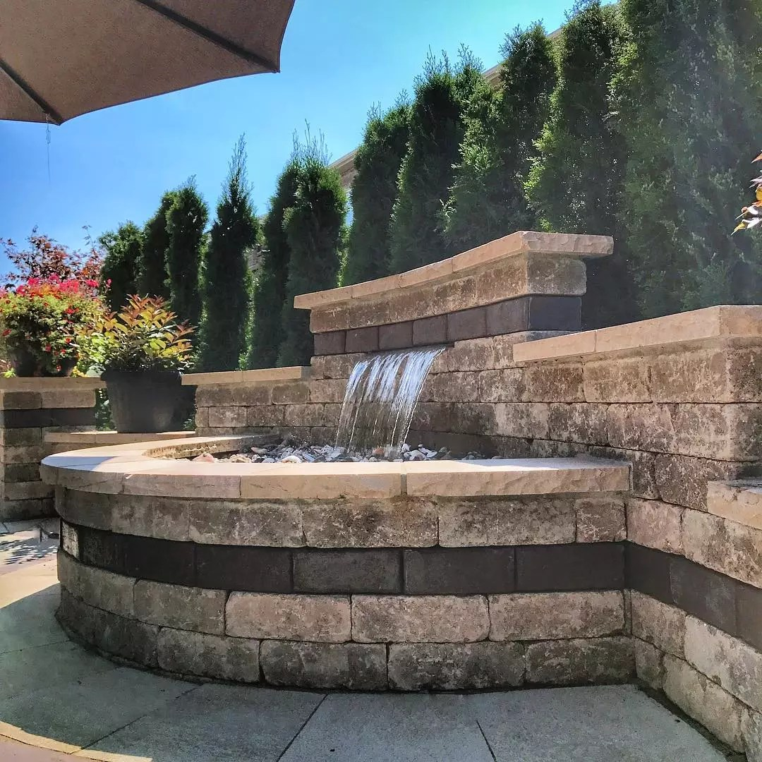 large recirculating water feature in outdoor living area photo by Instagram user @scenicstone