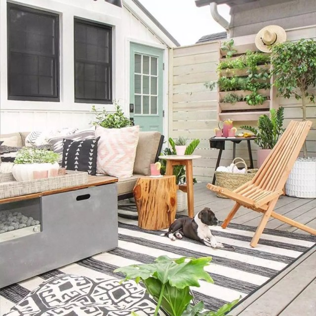 hanging plant wall set up next to outdoor living space photo by Instagram user @solehabitat