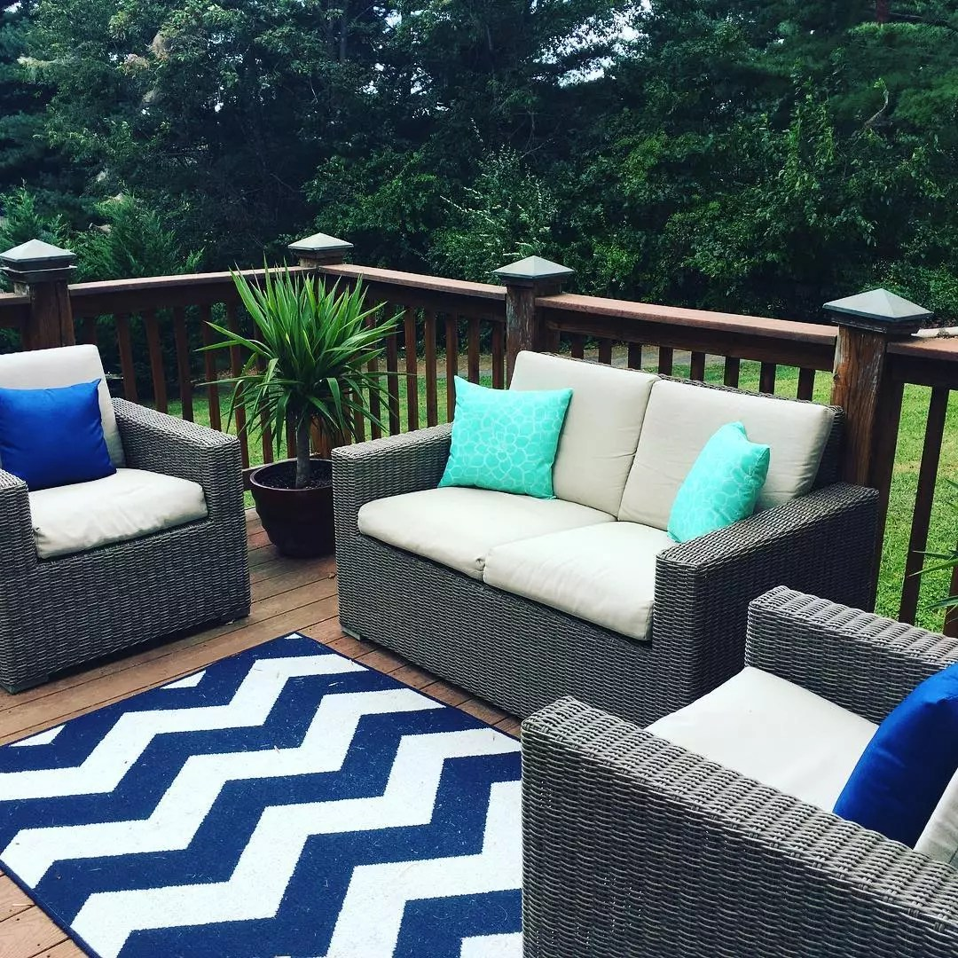 outdoor love seat and chairs sitting on an open deck photo by Instagram user @barb__herndon