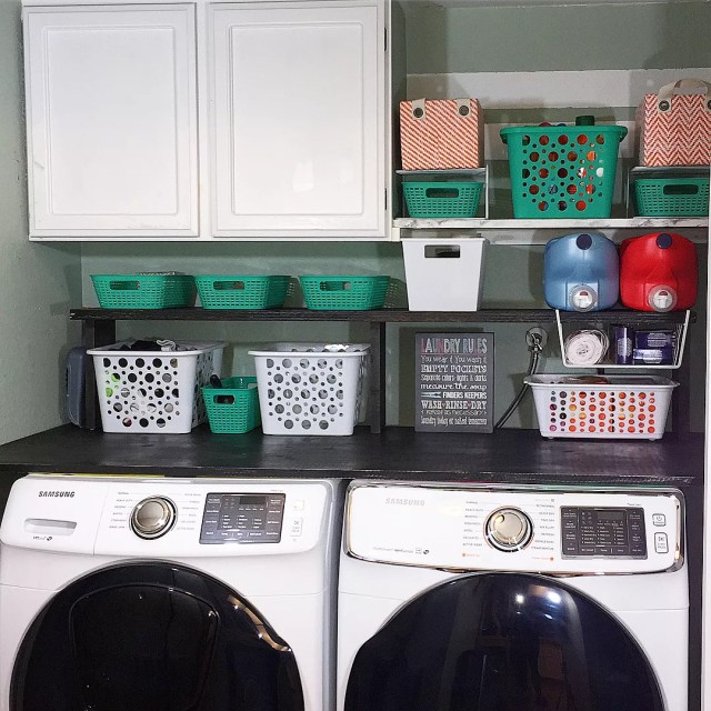 Laundry Room with Plastic Bins for Storage. Photo by Instagram user @unboxeddesigns