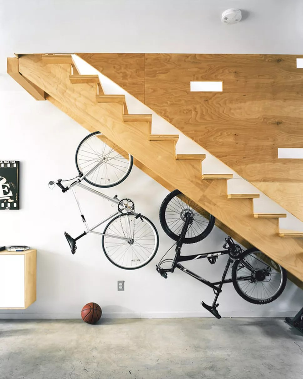 bikes hung up beneath stairs to save space photo by Instagram user @miamihomefinder
