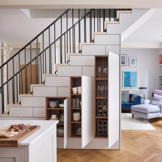 additional cabinet storage for kitchen dishes under the stairs photo by Instagram user @roundhouse_design