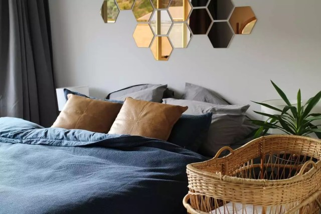 Minimalist modern bedroom with bassinet. Photo by Instagram user @leilamalthuscreative
