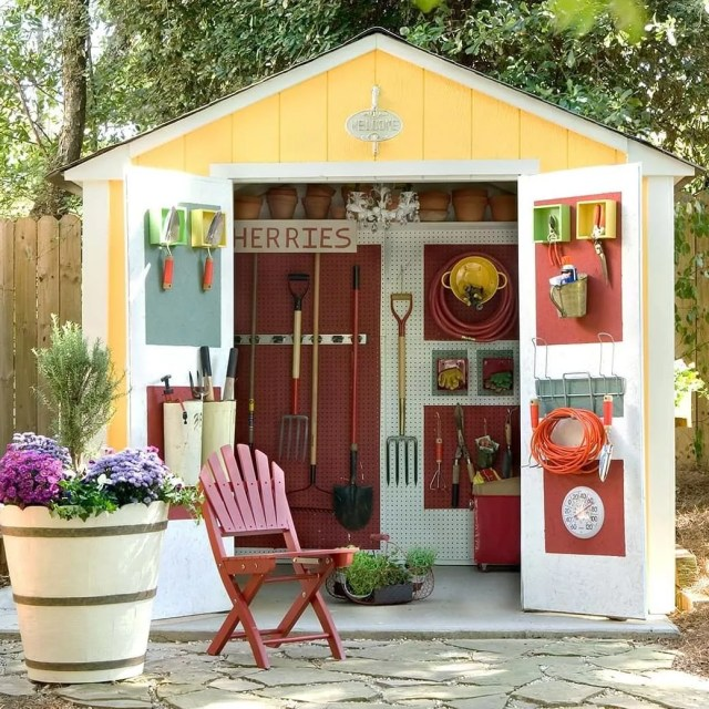 garden shed neatly organized with tools on the doors and walls photo by Instagram user @northkildonanrealtor