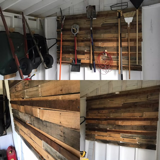 wheelbarrow hung up on shed wall next to pallet wall with tools photo by Instagram user @heatskymakershop