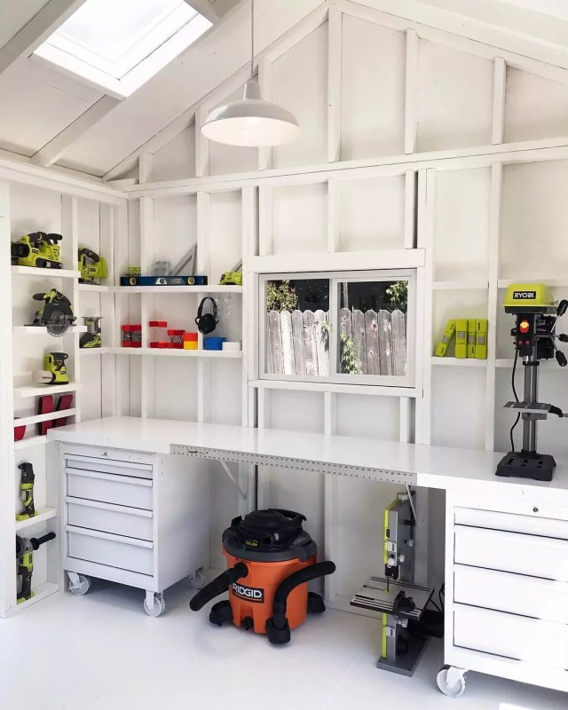 white workbench in shed with rolling storage tool chests photo by Instagram user @tuffshed