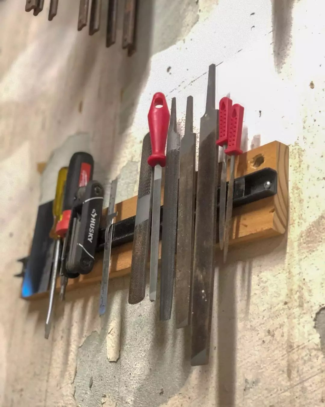 magnetic strip holding extra metal tools photo by Instagram user @cowdogcraftworks