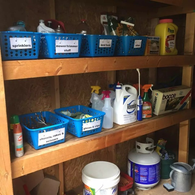 plastic storage bins holding garden tools on shelves photo by Instagram user @justbethmn