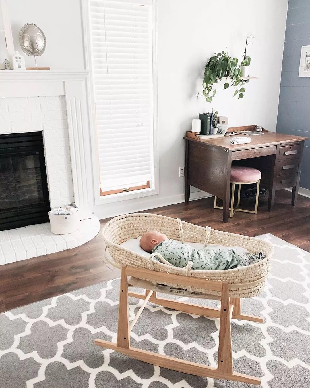 Baby sleeping in bassinet in living room. Photo by Instagram user @hellosparrows