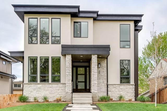 Front view of modern two-story home painted in a cream color with black trim. Photo by Instagram user @milehimodern