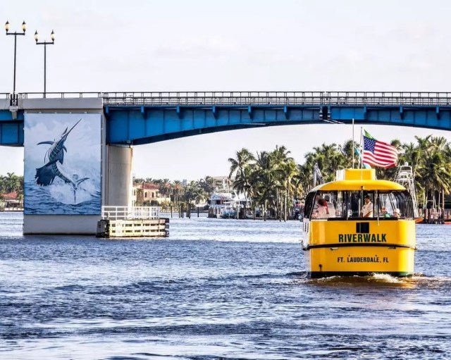 Water taxi strolls through a canal in Fort Lauderdale. Photo by Instagram user @fortlauderdalewatertaxi