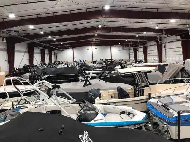 multiple boats being stored inside of a self storage facility photo by Instagram user @toygaragellc