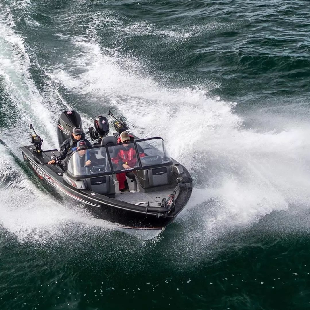 black aluminum fishing boat with three riders in the water photo by Instagram user @bps_boating_center_calgary
