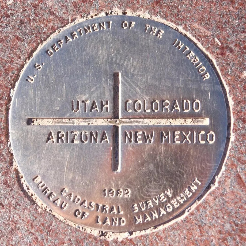 Marker on Ground Where People Can Stand in Arizona, Utah, Colorado, and New Mexico at Once. Photo by Instagram user @5280aperture