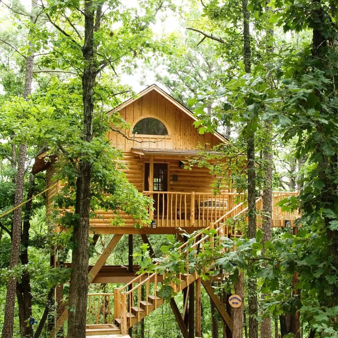 Elevated Treehouse Cottage in a Forest in Arkansas. Photo by Instagram user @treehousecottages