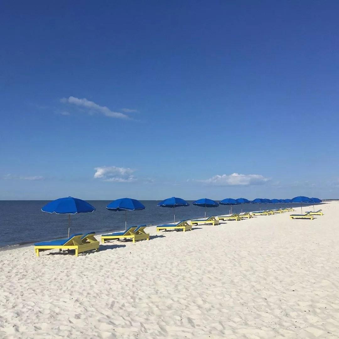 Mini Cabanas Set Up on a White Sand Beach at Biloxi Beach in Mississipi. Photo by Instagram user @gulfcoastbnb