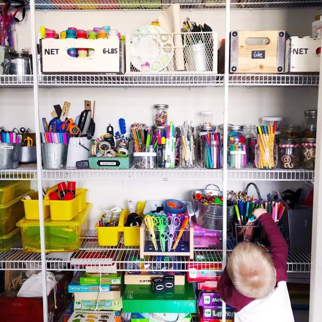 wire shelves in a closet set up for craft supplies photo by Instagram user @collinsschoolhouse