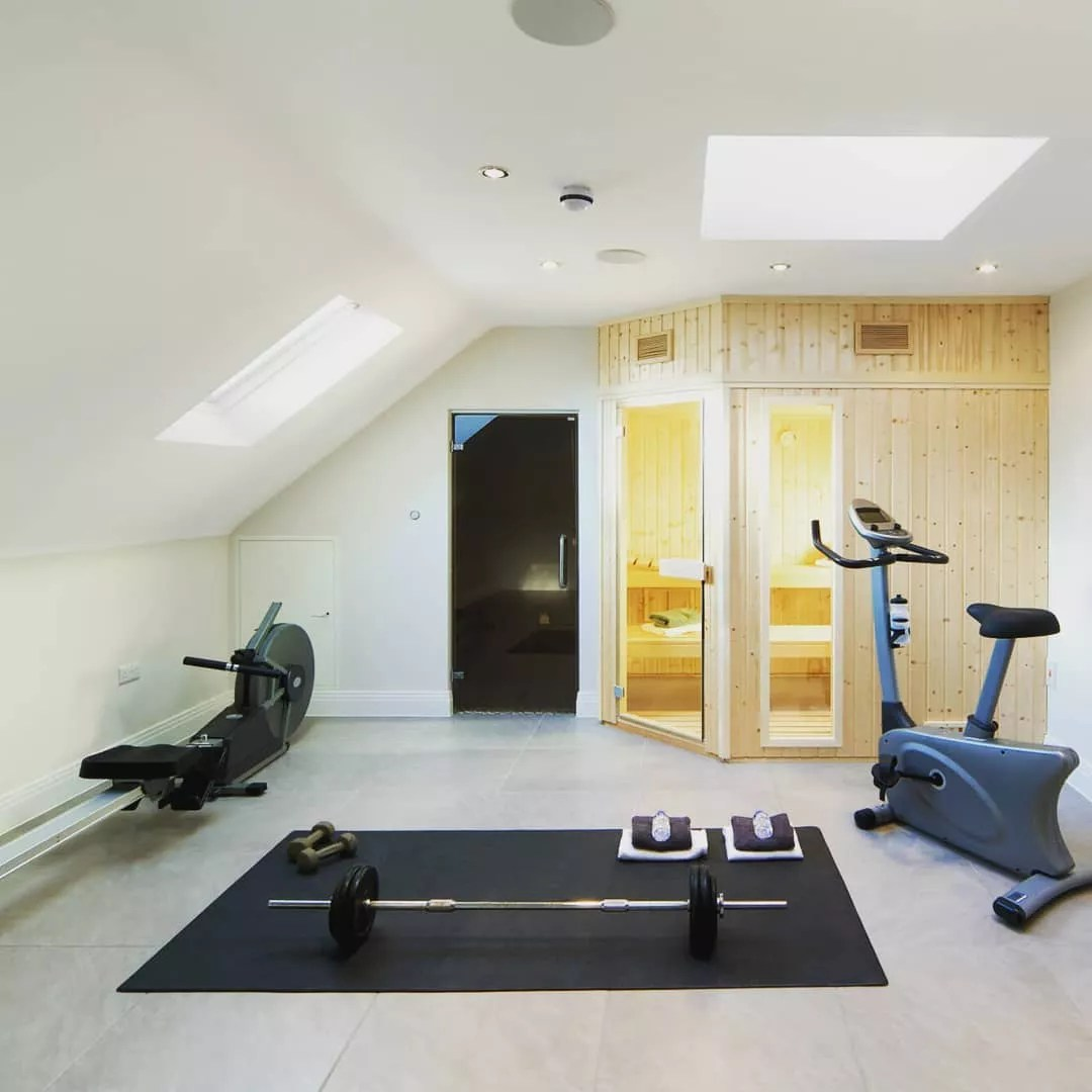 Home fitness center and sauna built into an attic space. Photo by Instagram user @valleycustomhomes