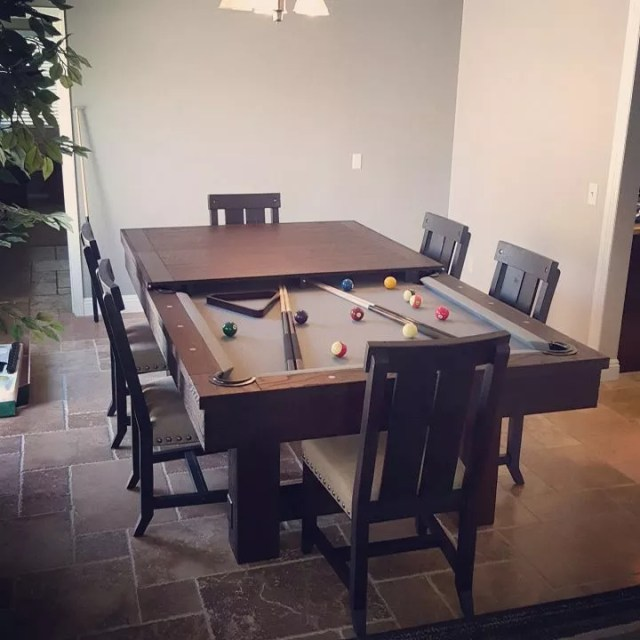 Wooden table with hidden pool table underneath. Photo by Instagram user @dkbilliards