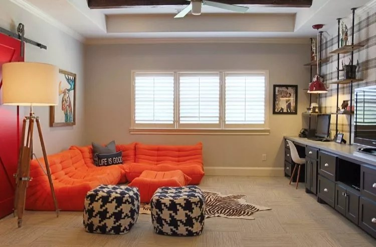 Kids game room with soft orange couches. Photo by Instagram user @angelineguidodesign