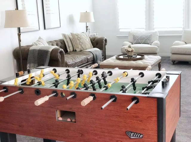 Foosball table in tan game room. Photo by Instagram user @casademorris