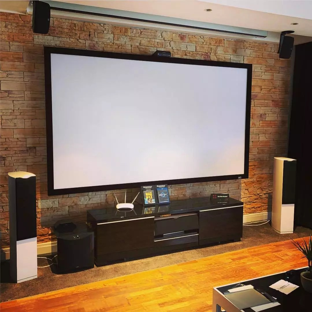 Giant projector screen in game room. Photo by Instagram user @elite_screens