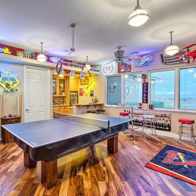 Game room with sport decor and ping pong table. Photo by Instagram user @desert_flats