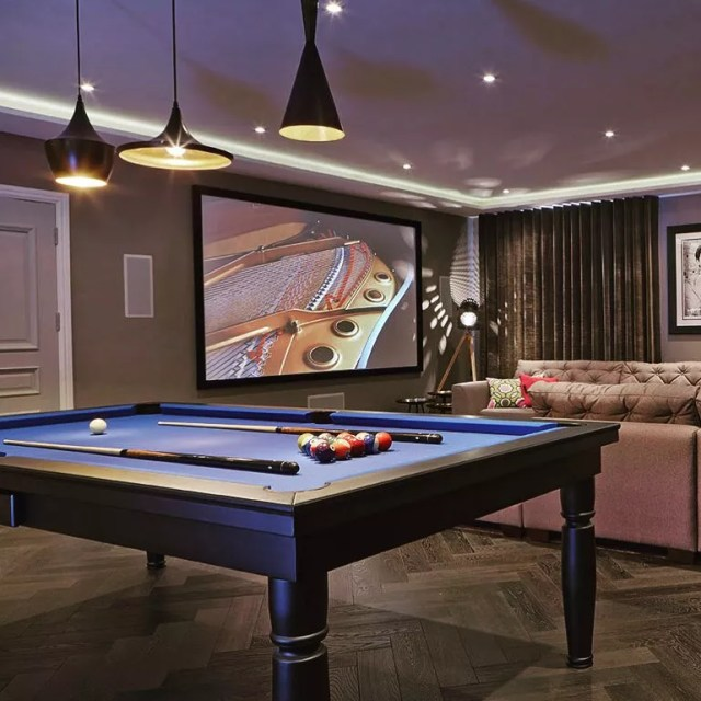 Navy blue pool table in game room. Photo by Instagram user @luxurypooltables