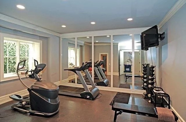 Fitness equipment set up in extra bedroom of home. Photo by Instagram user @bh_interior_ideas