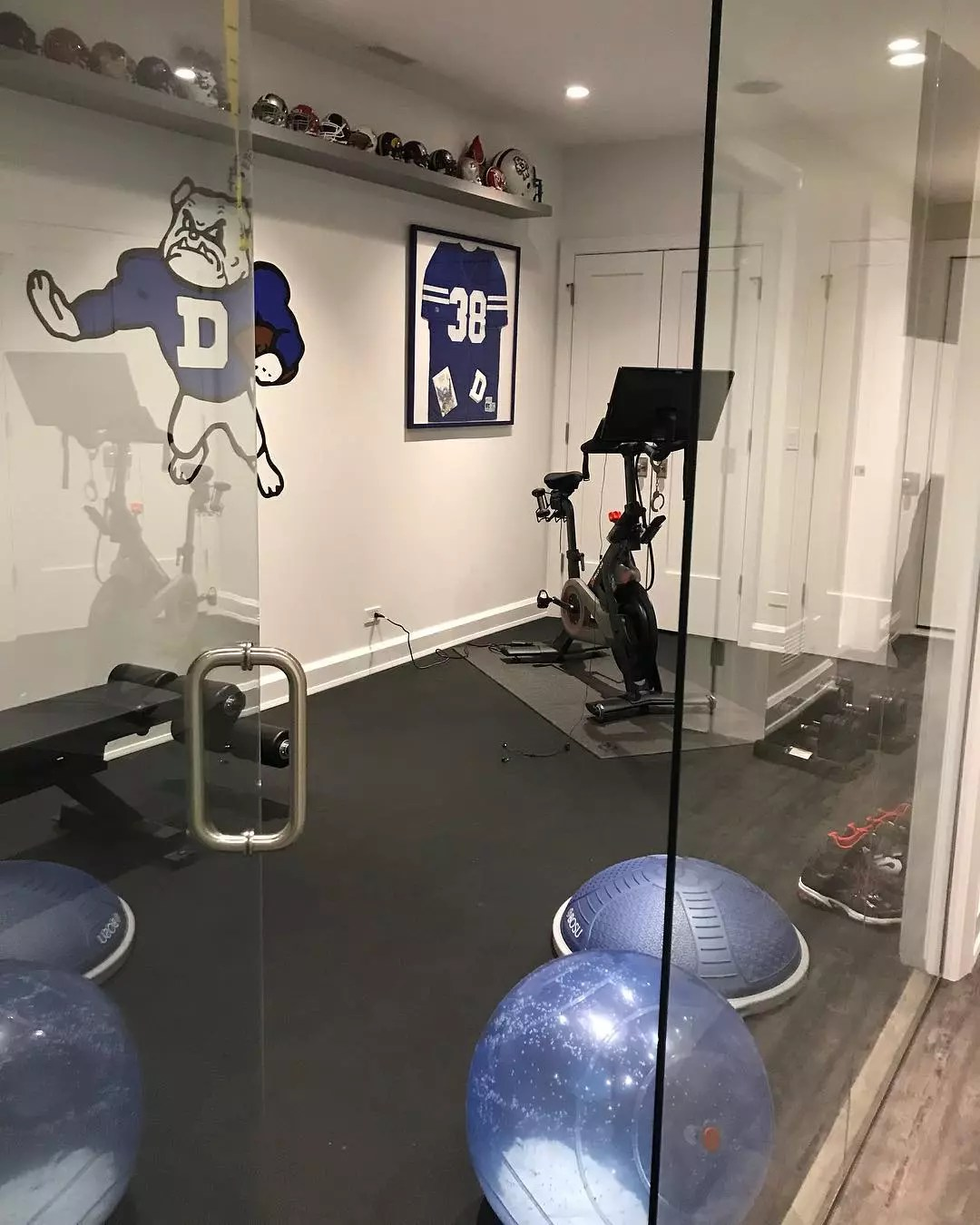 Fitness room in home decked out with Drake University wall decor. Photo by Instagram user @jamieschachteldesign