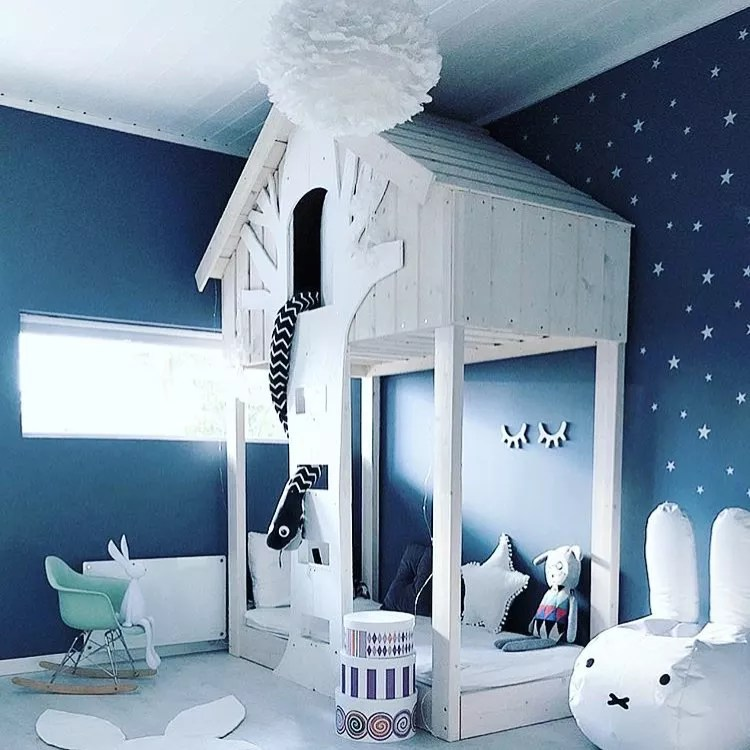 Navy room with kids tree fort with bed. Photo by Instagram user @babytalk