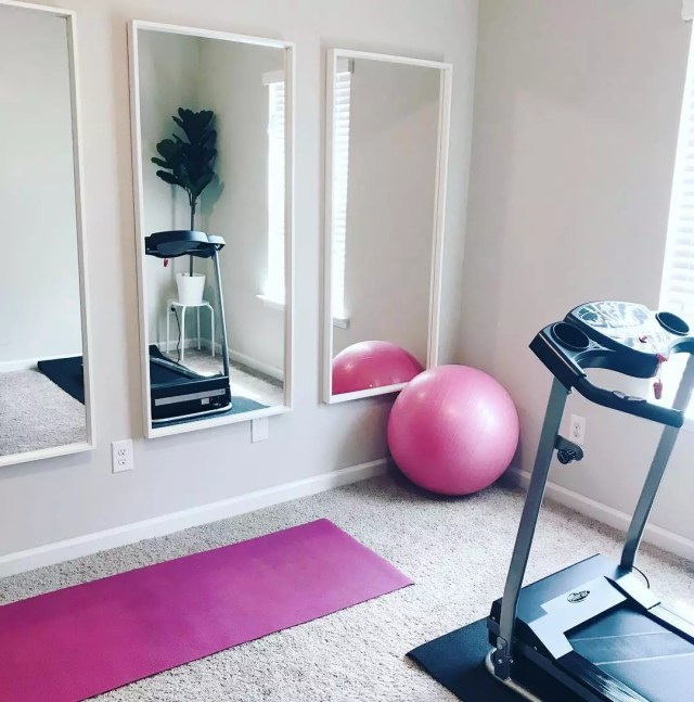 Three mirrors on wall in home fitness room. Photo by Instagram user @cara_lanelle