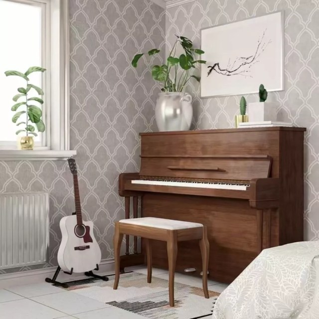 small piano and white guitar in music room with plants nearby photo by Instagram user @lujo.vivo