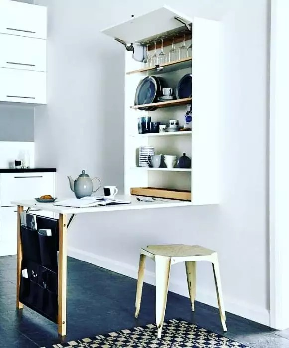Fold-down table with bench chair in studio apartment. Photo by Instagram user @wallytables