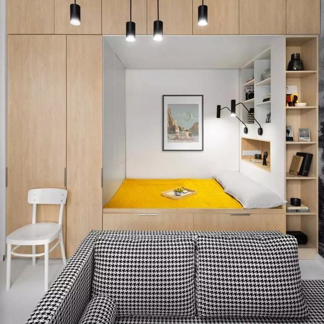 bed with closet built in and storage placed around it photo by Instagram user @reklektik