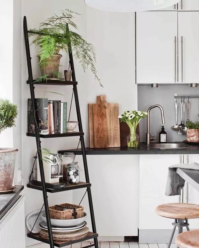 Storage shelf in studio apartment kitchen. Photo by Instagram user @goodhomesmagazine