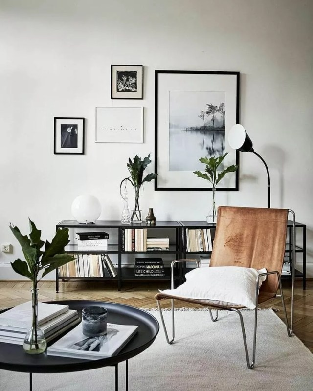 small apartment with exposed leg chair and black furniture photo by Instagram user @ineslarsson